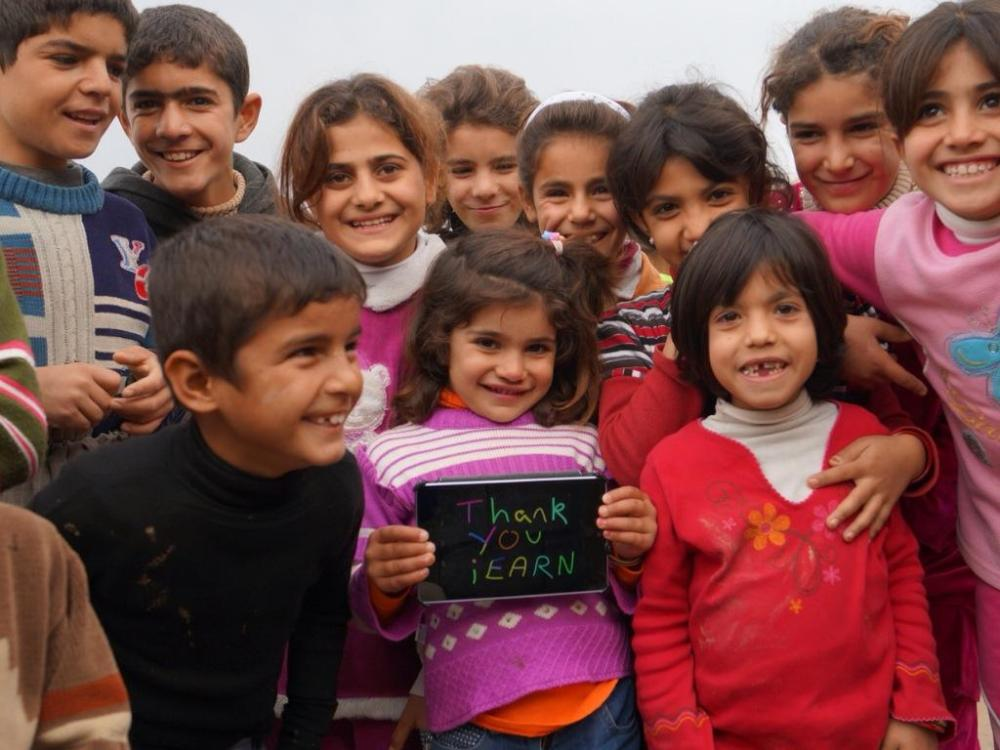 Kids in Lajan Village, Kurdistan, Iraq, use a tablet for the first time.