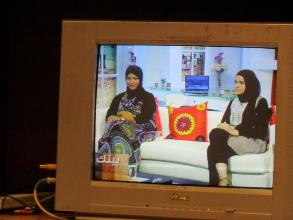 "Student Rawan Alkandari with her teacher Ashwaq Alattal (right) from Fatima Alsarawi school on ""Baitak,"" Kuwait TV."